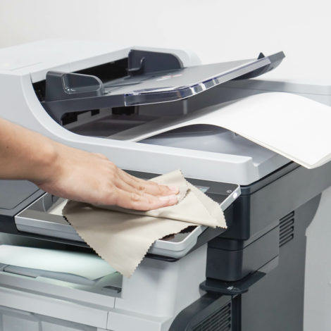 Photocopier being cleaned